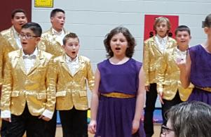 Dig those gold jackets! The Show Choir knows how to light up the stage.