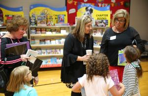 Principal Decker greets guests during Grandparents/Special Friend day